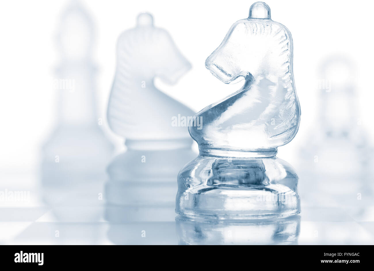 transparent glass chess pieces isolated on white - Stock Image