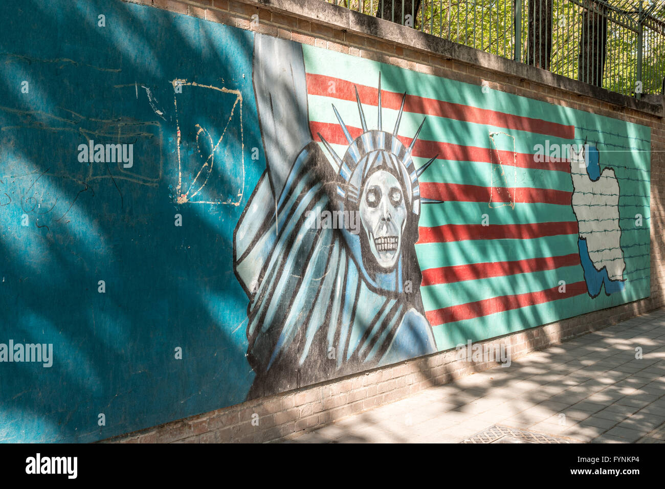 Anti-American sign from the Iranian Revolution in front of the former American Embassy. - Stock Image