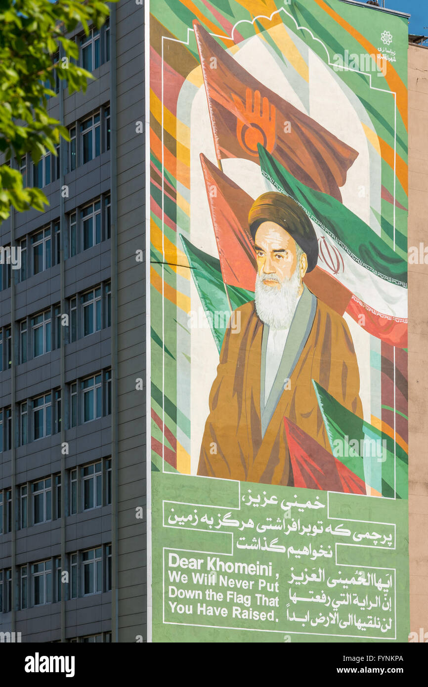 Sign supporting Khomeini and the Iranian Revolution on a building in downtown Tehran, Iran. - Stock Image