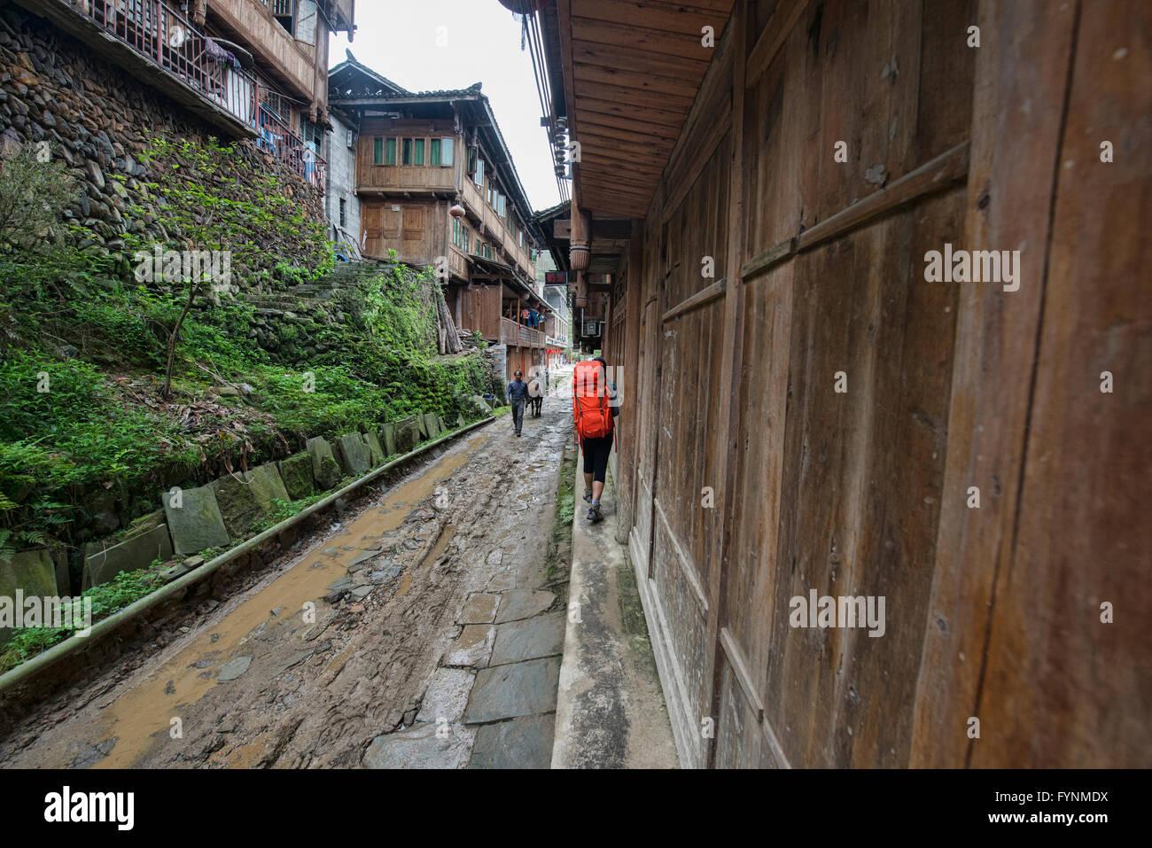 Trekking throught the old Yao village of Dazhai, Guangxi Autonomous Region, China Stock Photo