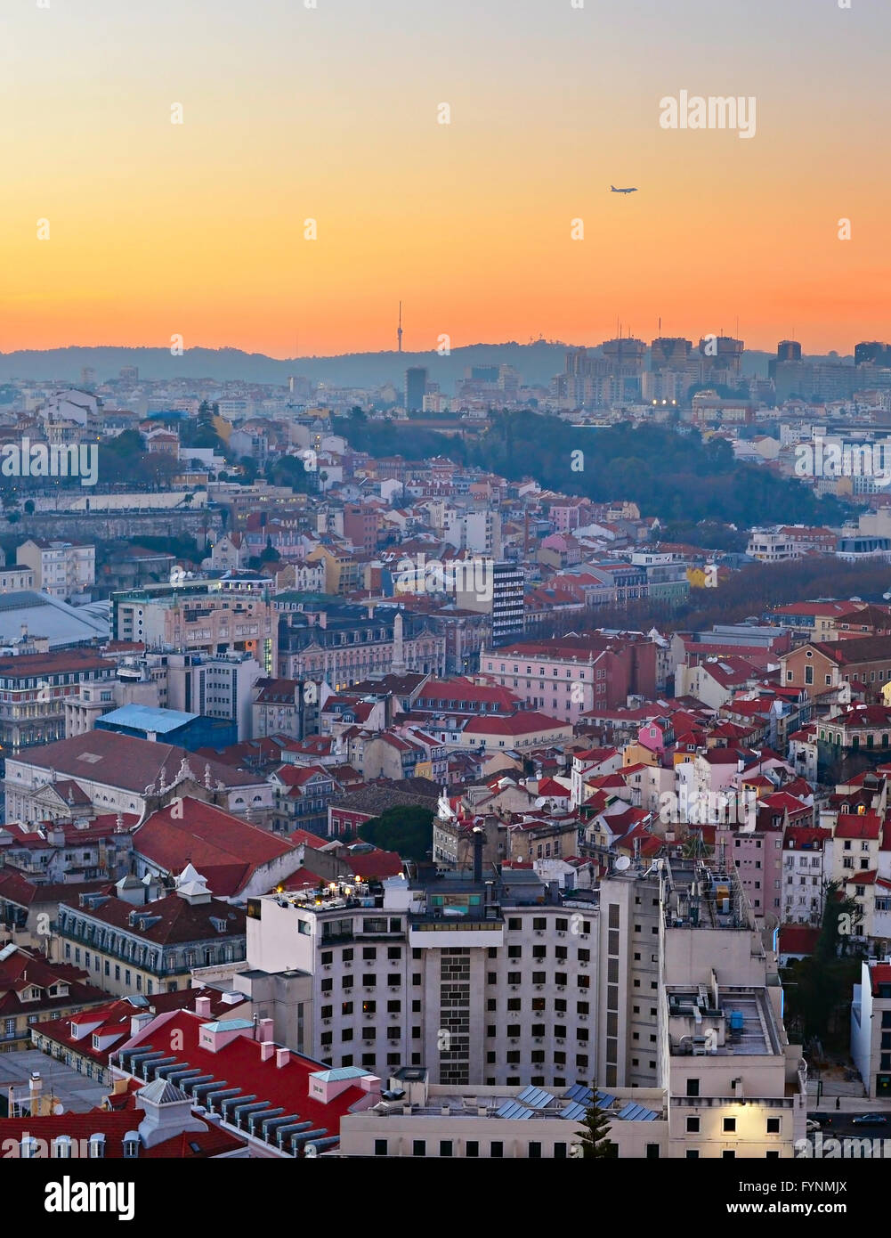 Airplane flying over the Lisbon city. Portugal - Stock Image