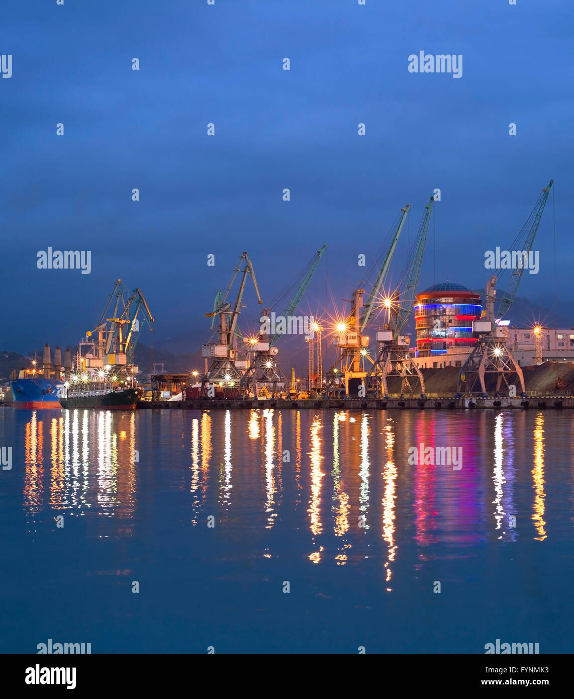 Industrial sea port with reflection in the water. Batumi, Georgia - Stock Image
