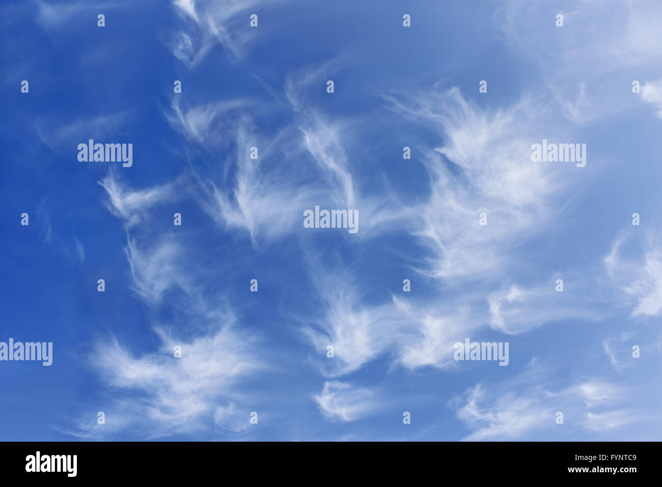 Group of fanciful white clouds - Stock Image