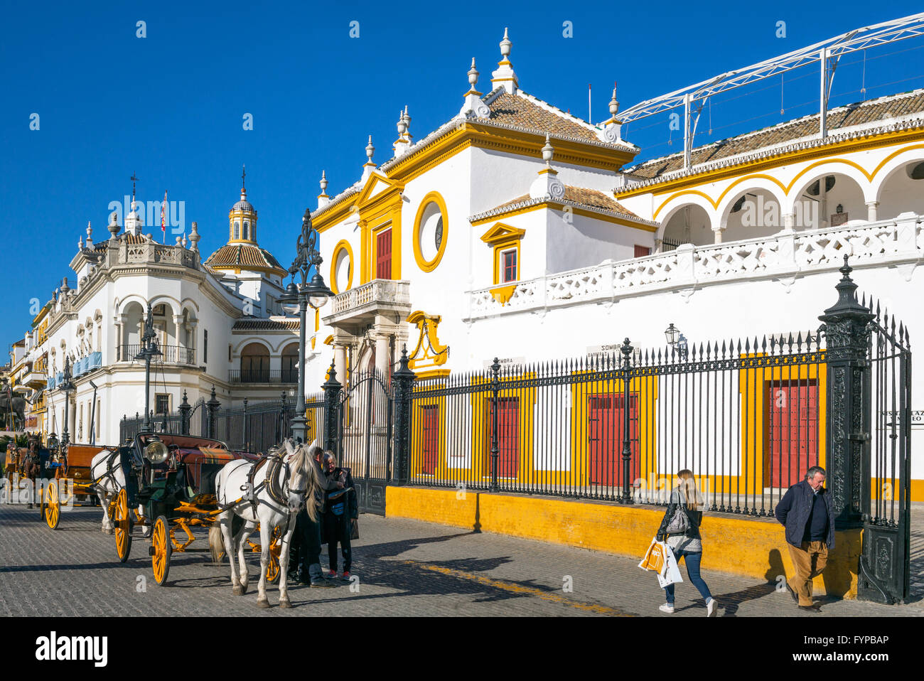 Spain, Andalusia, Seville, carriages in front of the Plaza de Toros (Bullring) and Real Maestranza de Caballeria - Stock Image