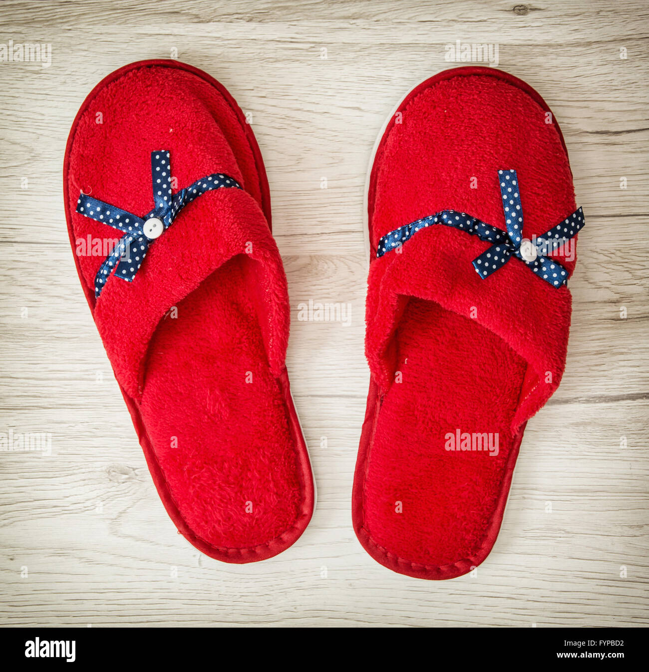 93313c26550 Red slippers with blue ribbon on the wooden background. Beauty and fashion.  Retro style. Indoor slippers.