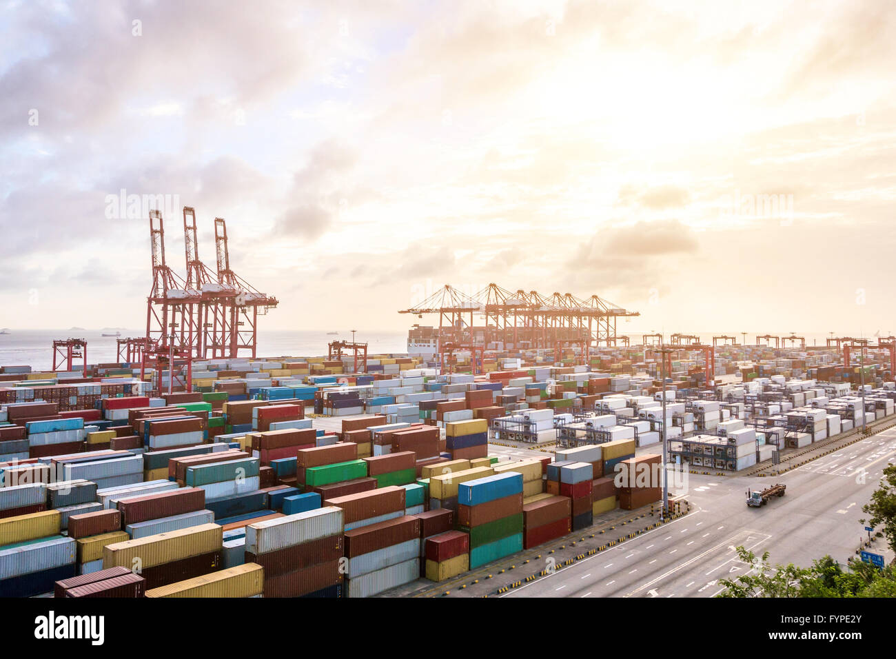 Industrial port at dawn at the Port of shanghai - Stock Image