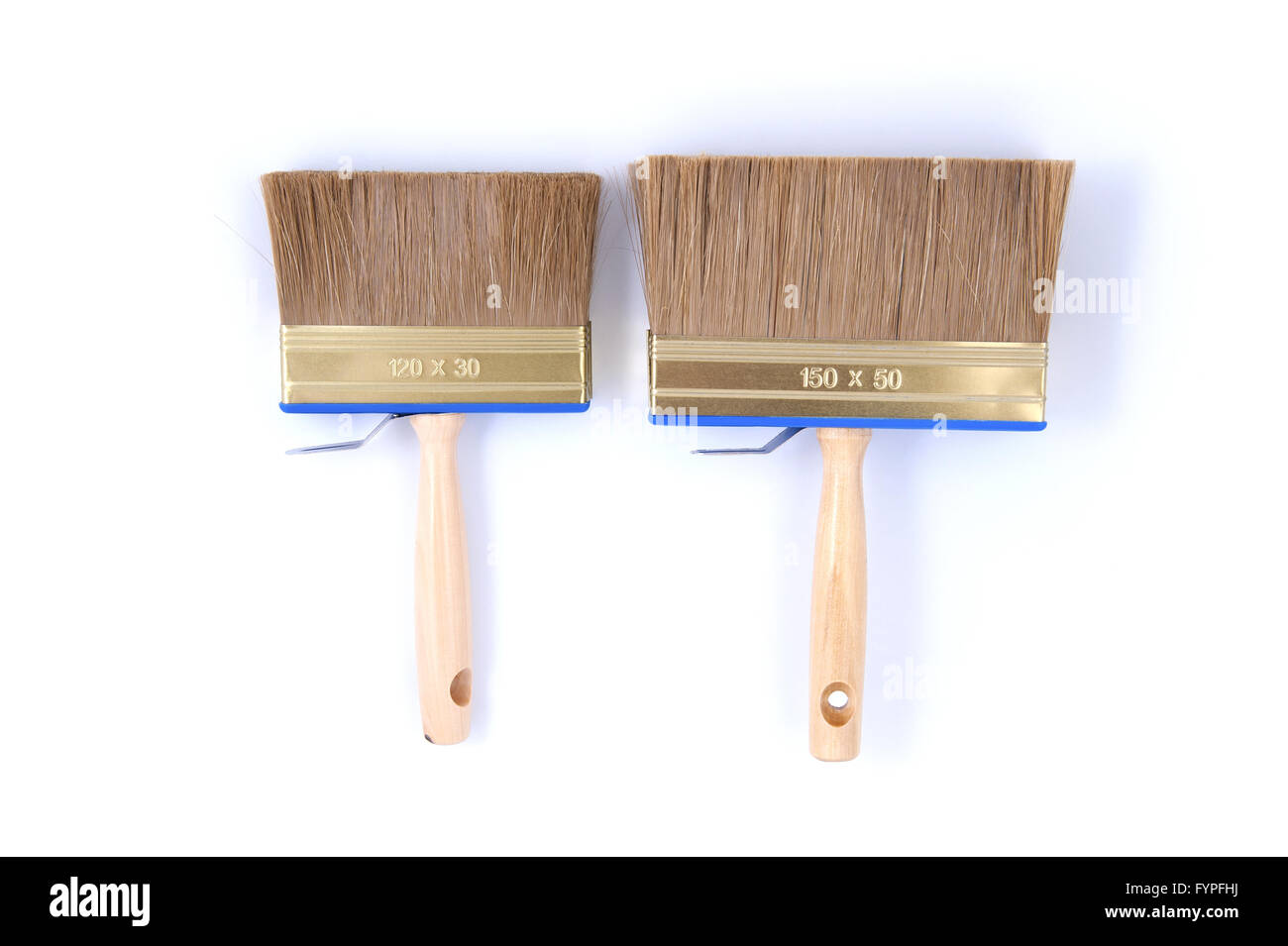 Two paint brushes of different sizes. - Stock Image