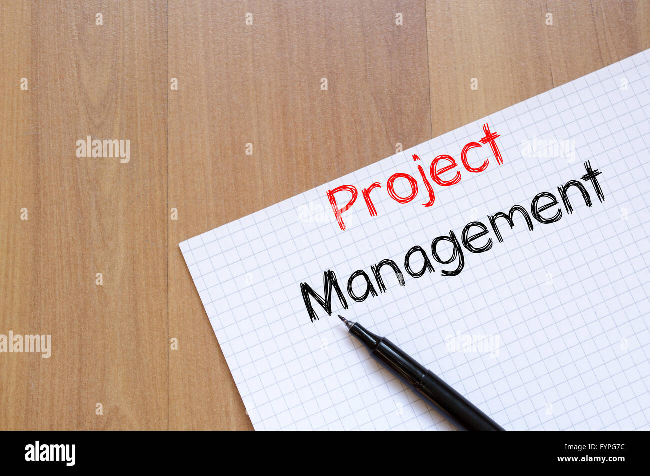 Project management write on notebook - Stock Image