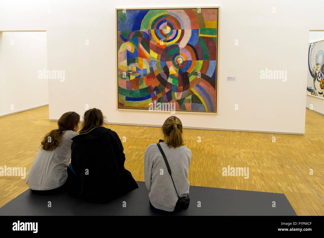 Young girls study Electric Prisms, Prismes electriques,  by Sonia Delauney 1914, Centre Pompidou, Paris, France, - Stock Image