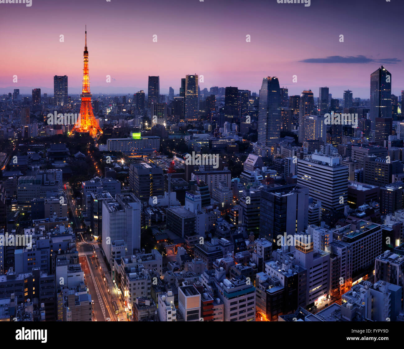Aerial cityscape with Tokyo Tower illuminated in twilight, Minato, Tokyo, Japan - Stock Image
