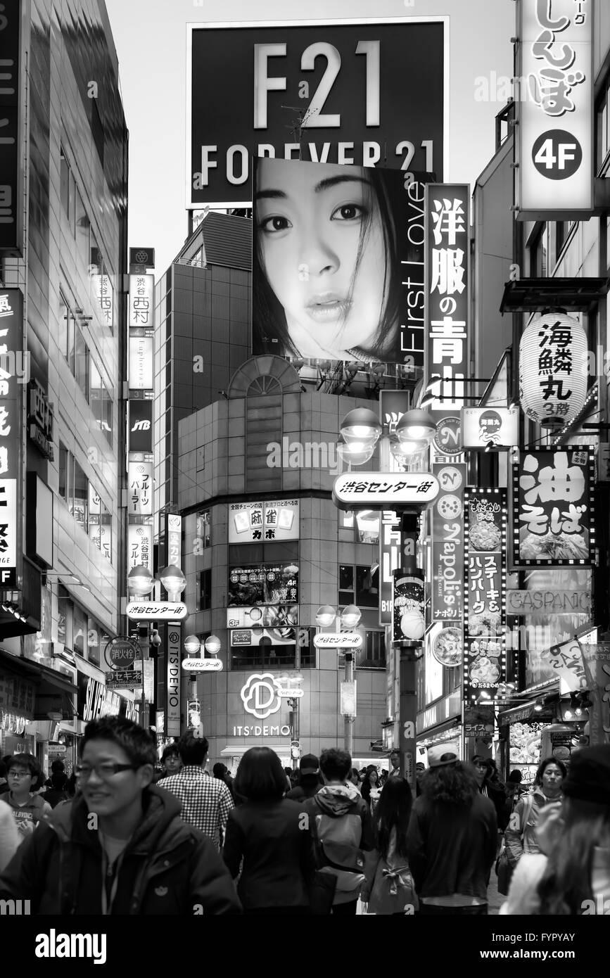 People on busy street with billboards, Shibuya, Tokyo, Japan - Stock Image