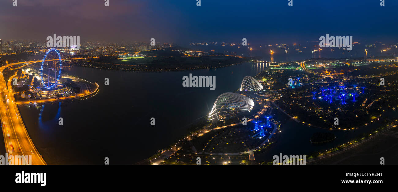 Ferris wheel and Gardens by the Bay, Flower Dome, night, Singapore - Stock Image