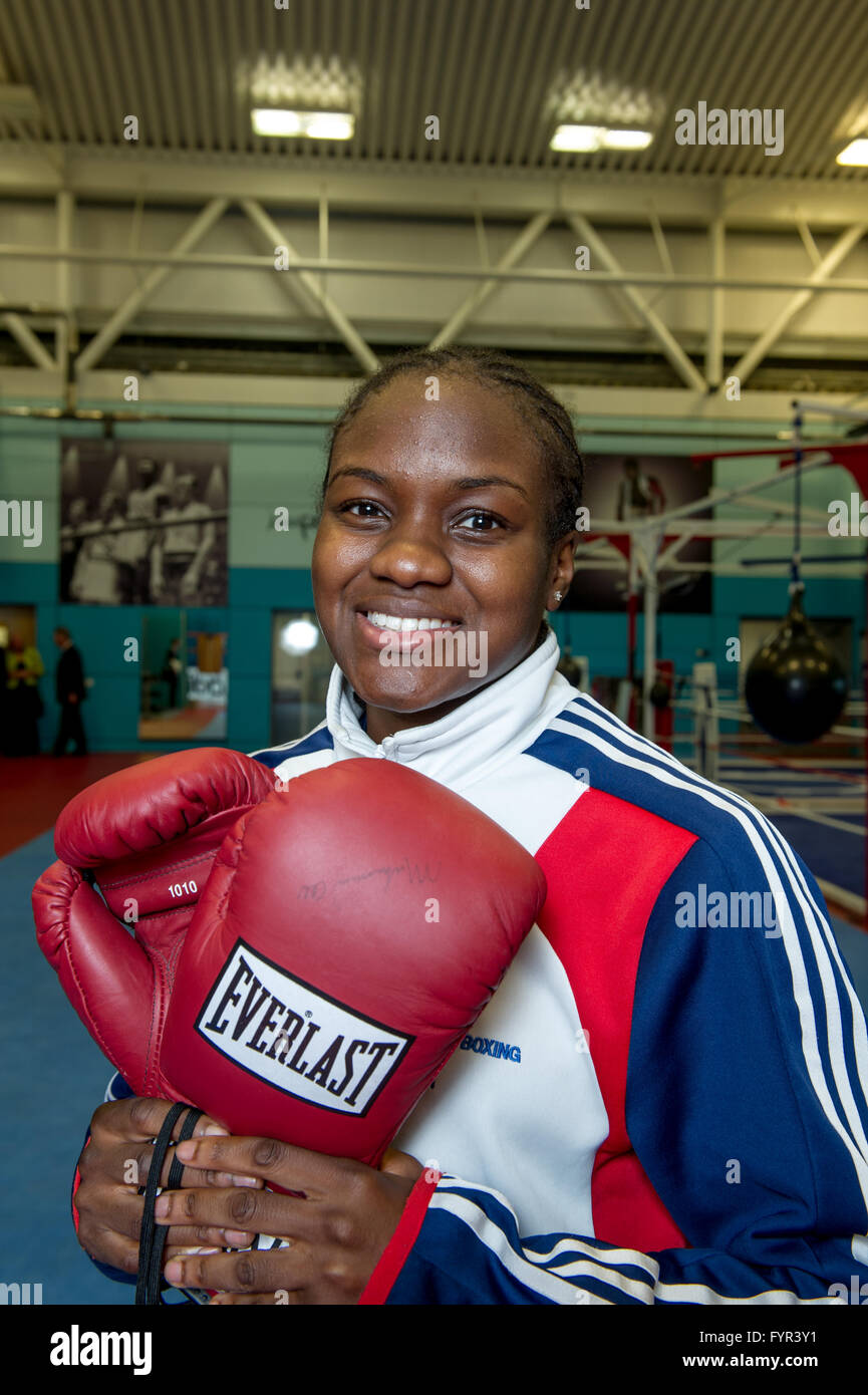 British Olympic Boxing Flyweight Gold medalist, Nicola Adams, holding a pair of boxing gloves signed by Muhammad - Stock Image