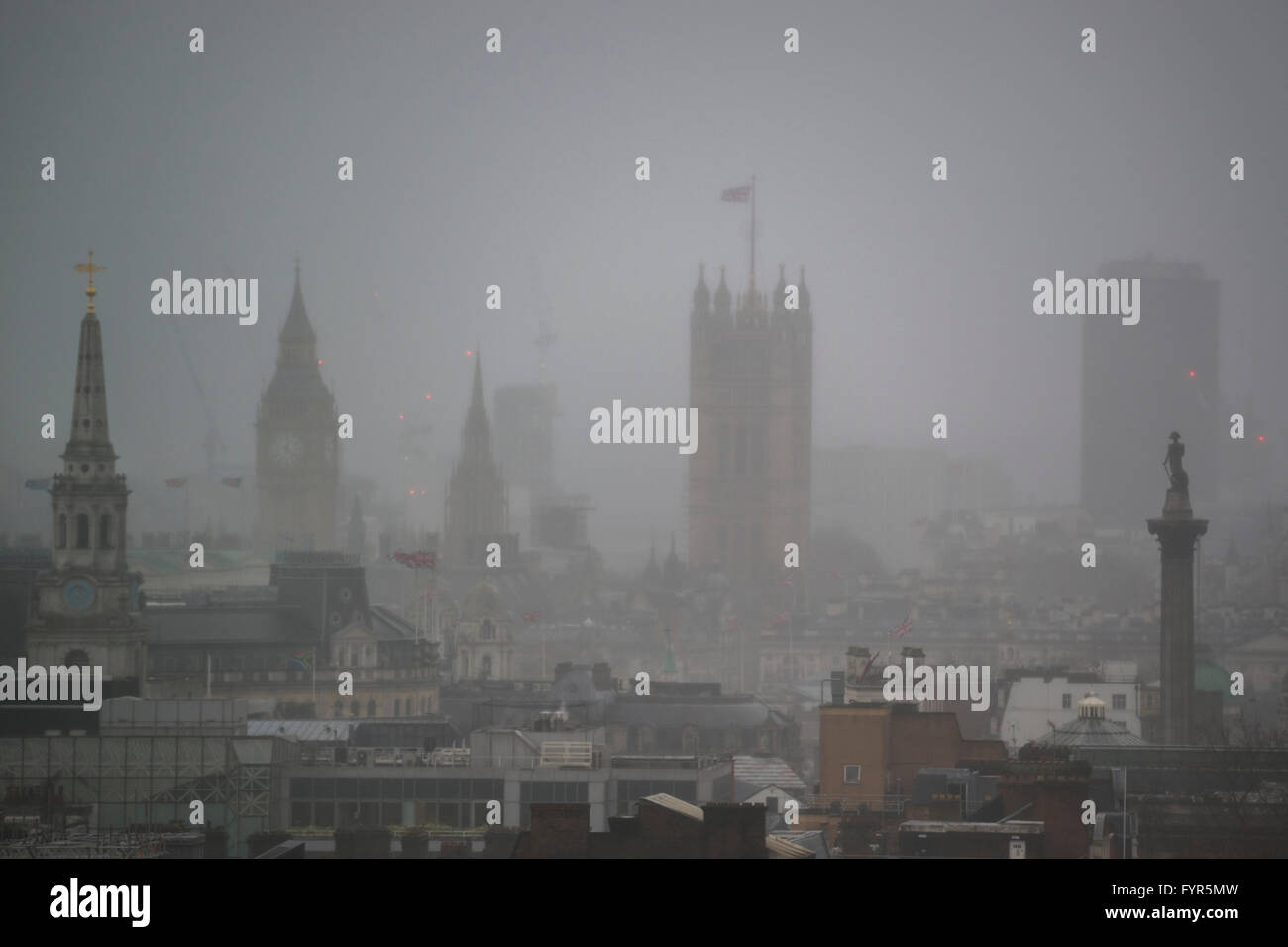 Worries about pollution and poor air quality in London are growing. They are highlighted on naturally foggy days, - Stock Image