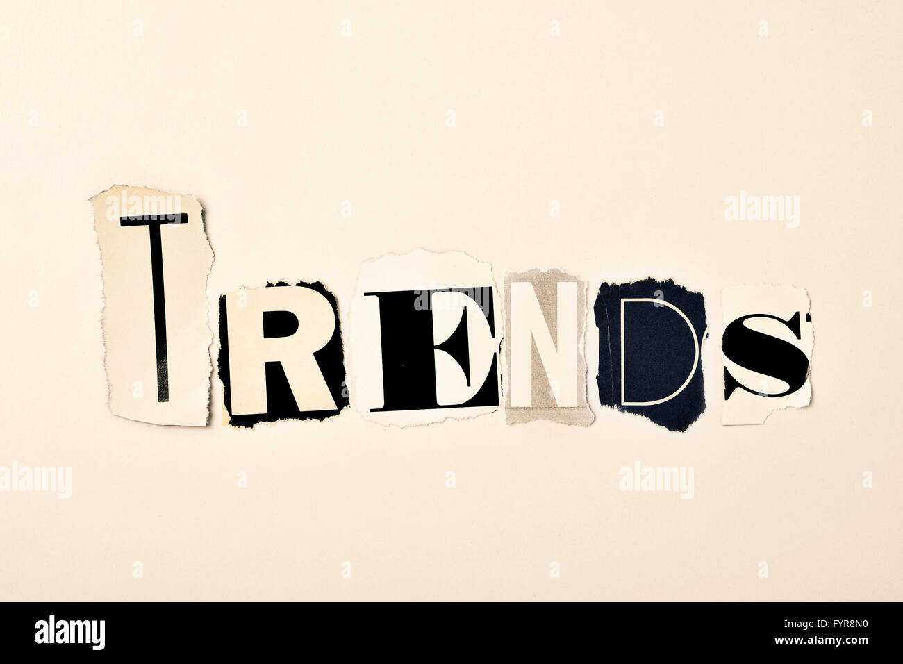 the word trends written with different letters made of clippings of newspapers and magazines, on an off-white background - Stock Image