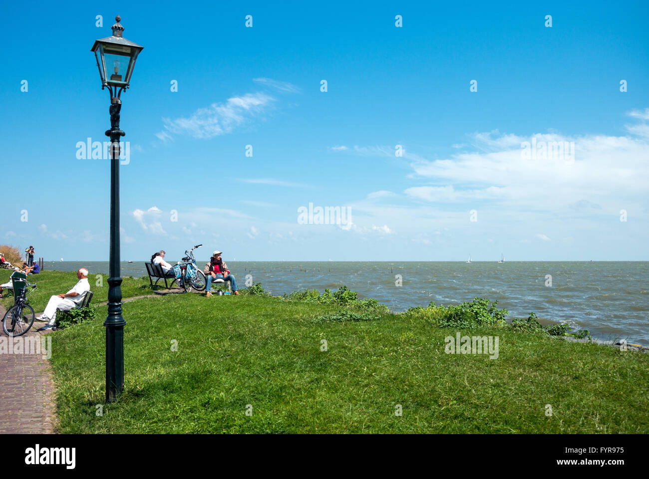 Amsterdam, Waterland district, Volendam, people on the seafront Stock Photo