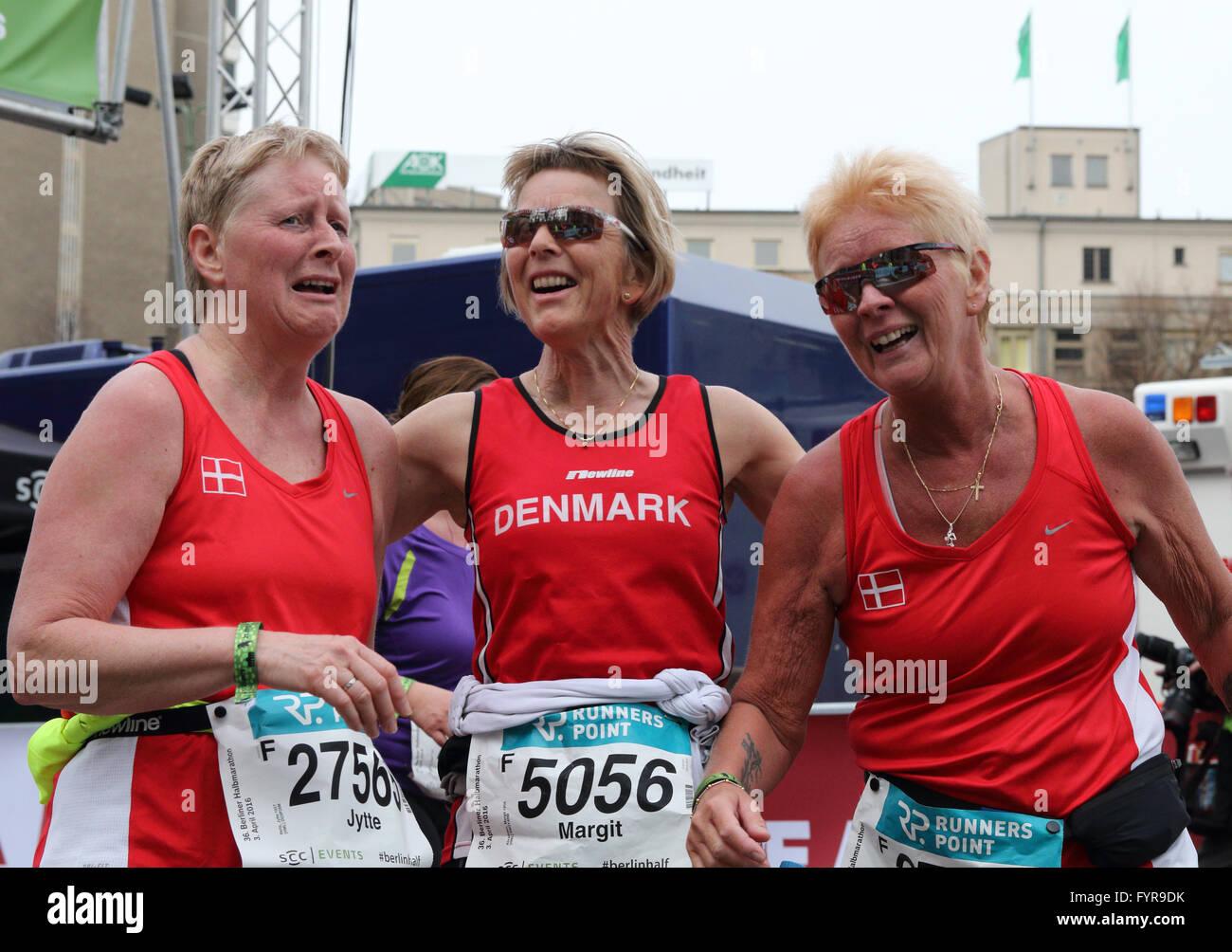 Three women from Denmark just after finishing the Berlin Half Marathon. - Stock Image