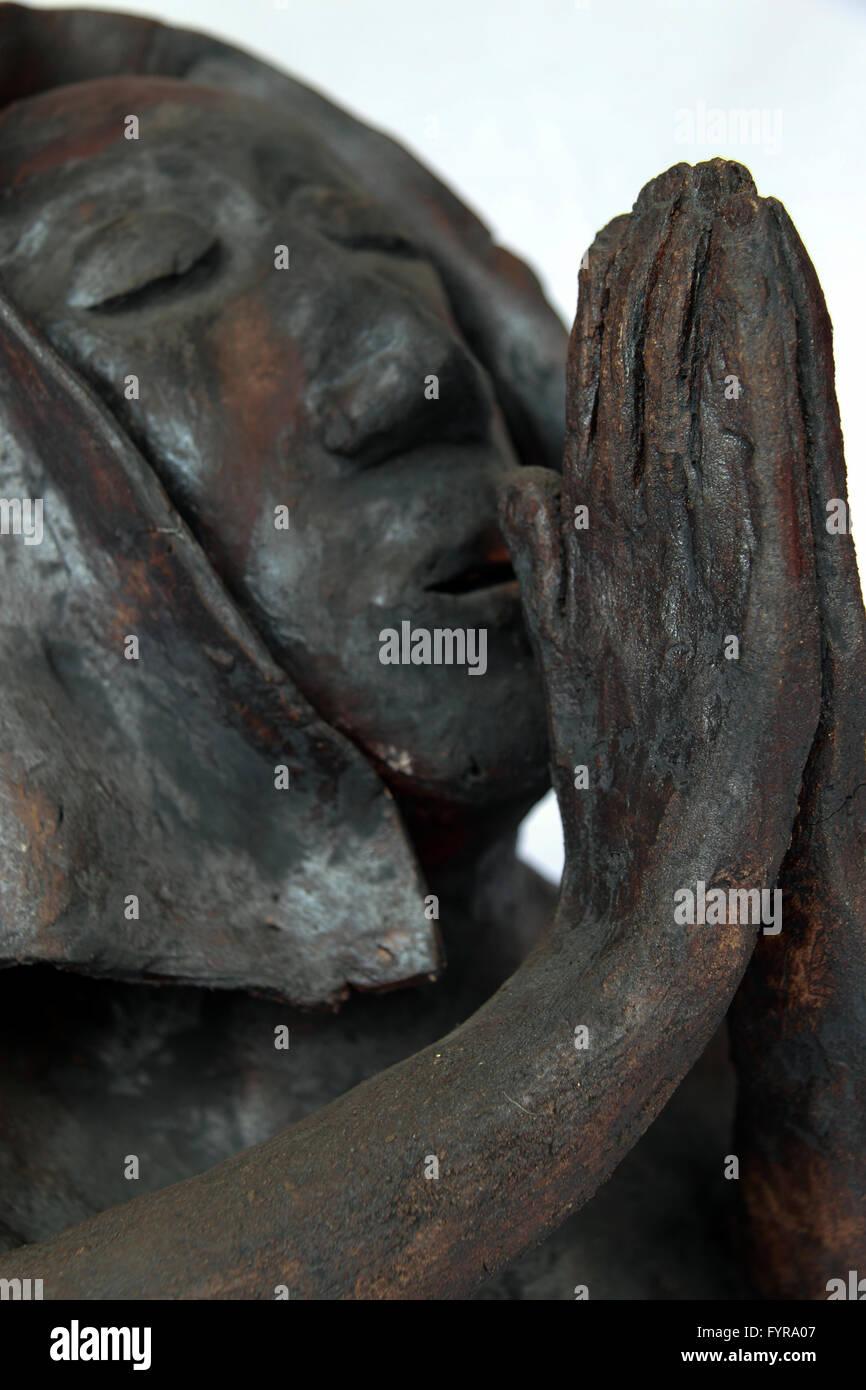 Ceramic head praying nun prayer bust pottery - Stock Image