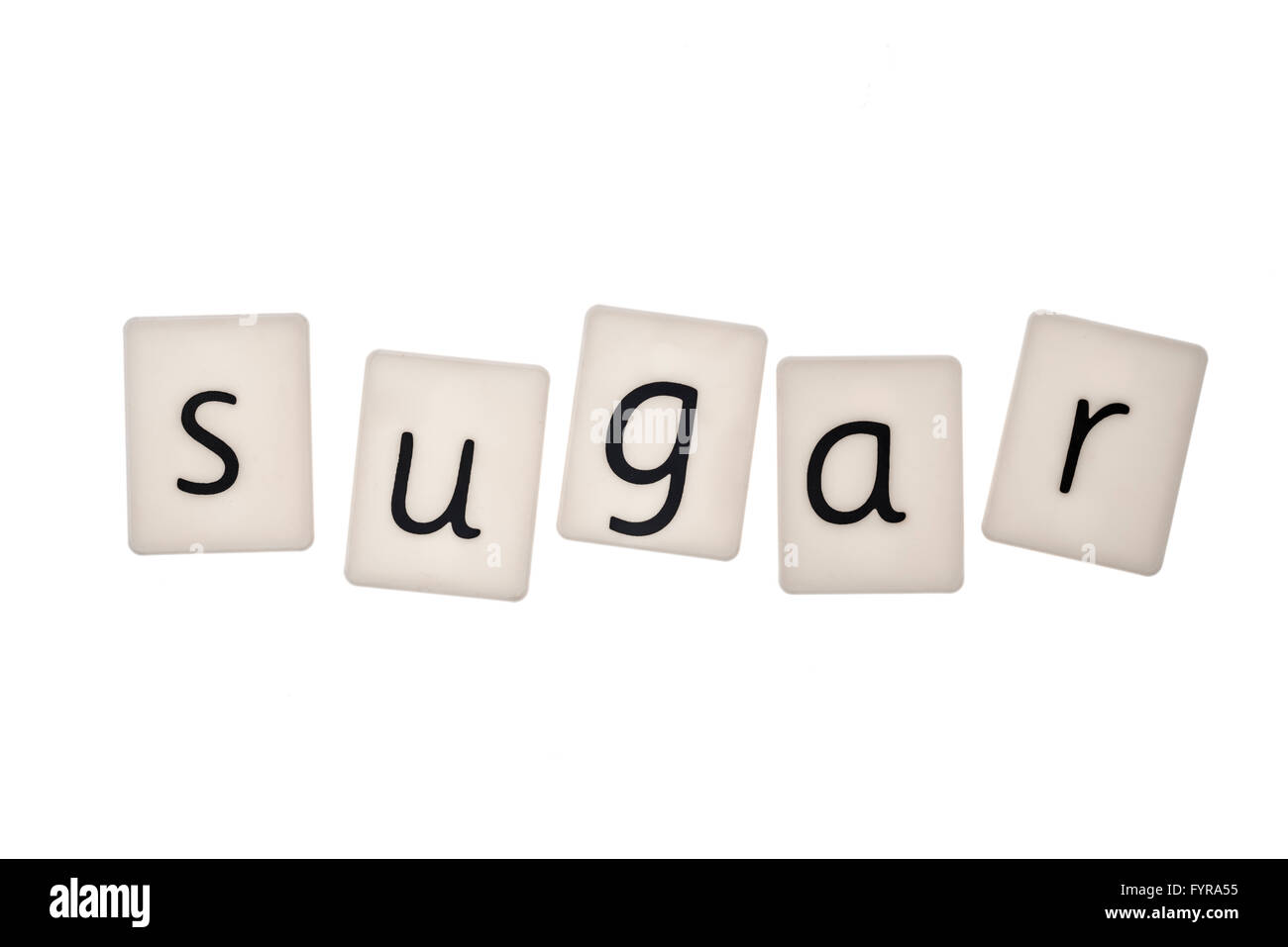 Plastic letters on white background spelling the word sugar - Stock Image