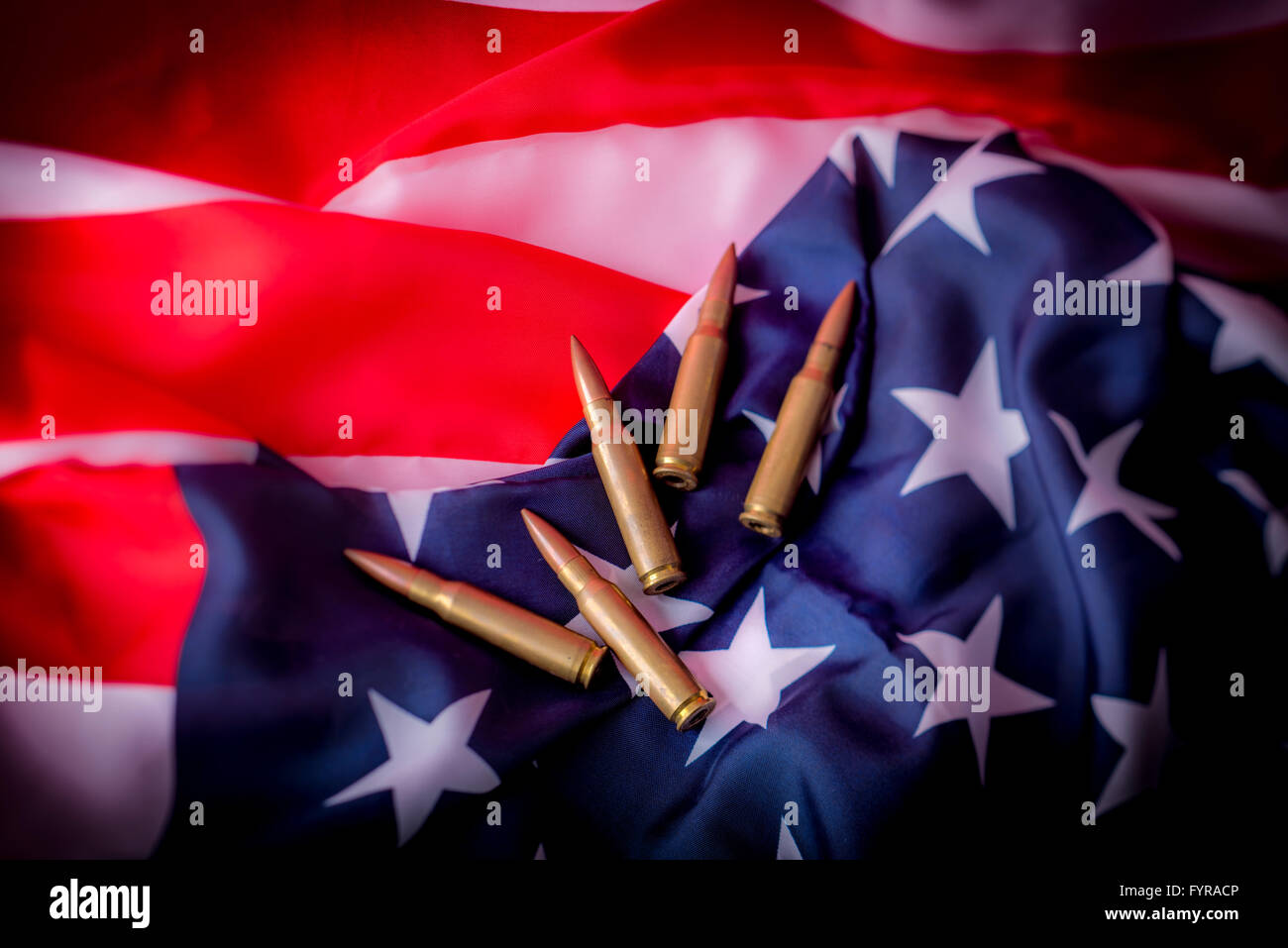 Bullets and American flag - Stock Image
