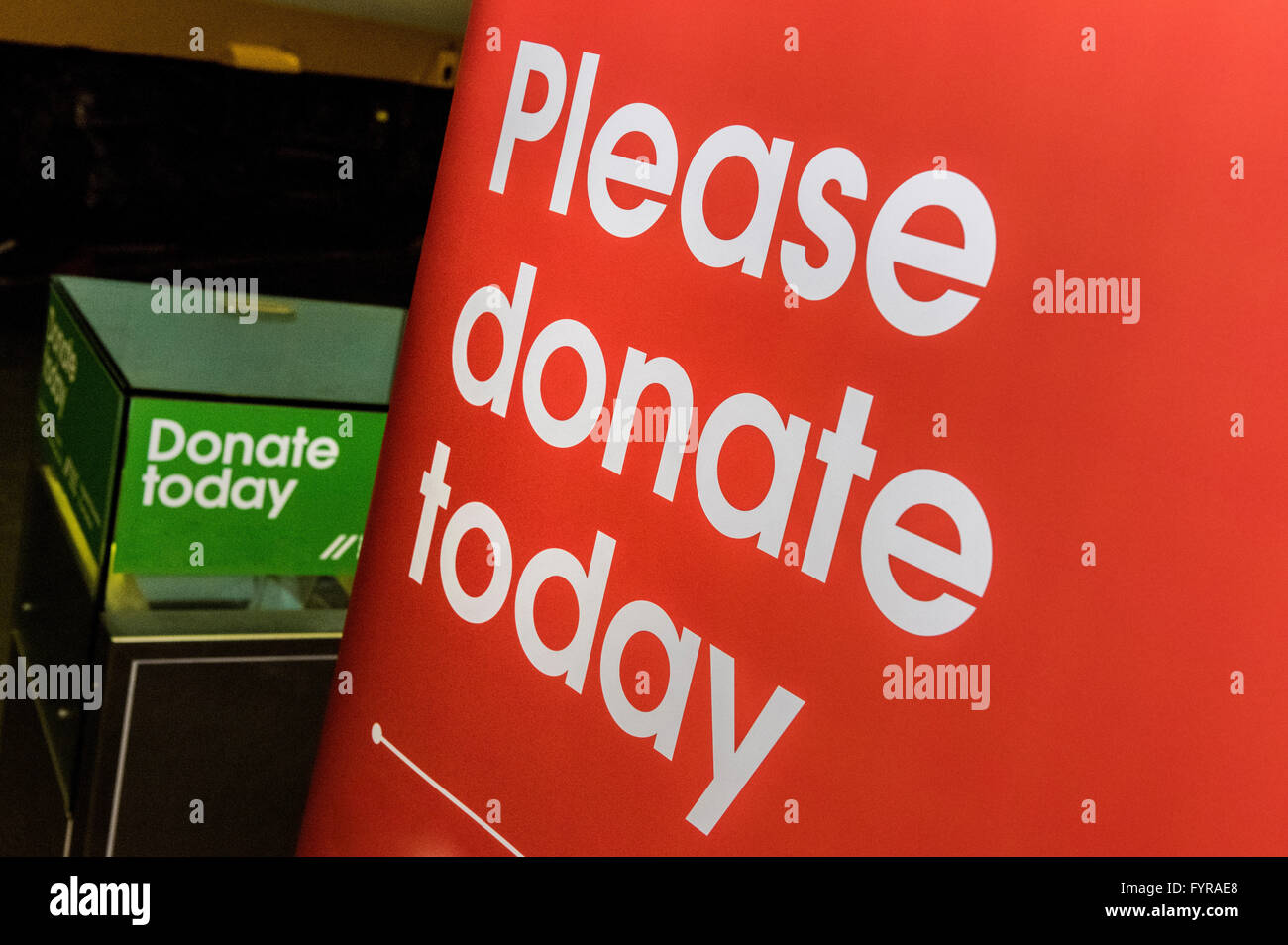 Please donate today sign - Stock Image