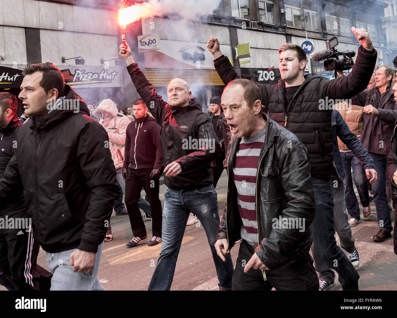 Tensions mounted in Place de la Bourse after a peaceful march was disrupted by approximately 200 far-right football - Stock Image