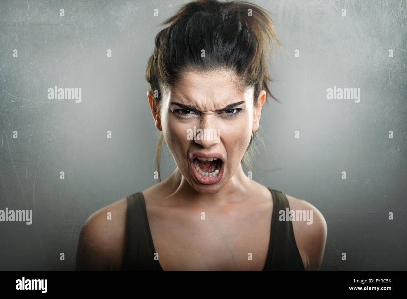 Scream of angry upset young woman - Stock Image