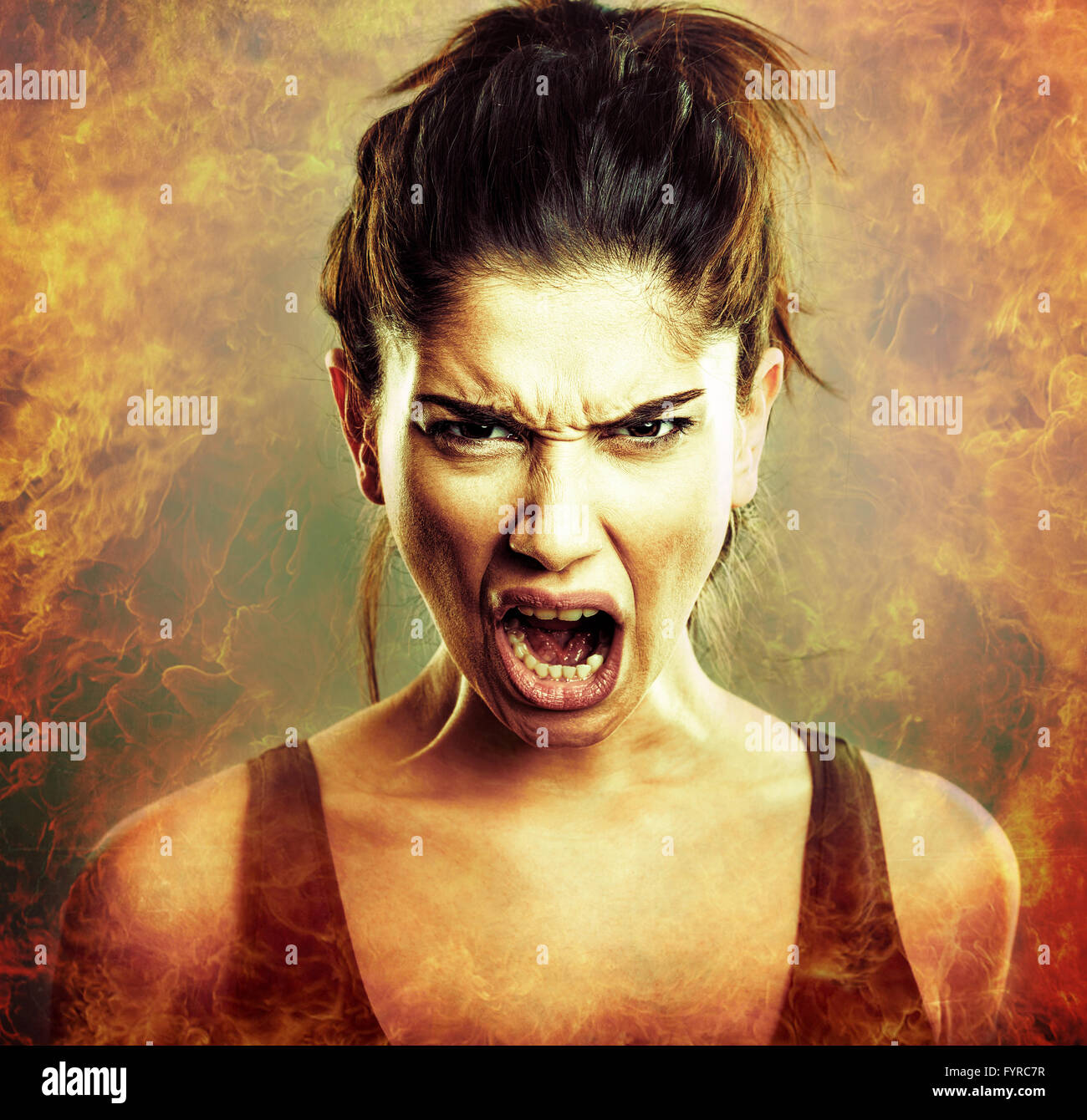 Rage explosion. Scream of angry young woman - Stock Image