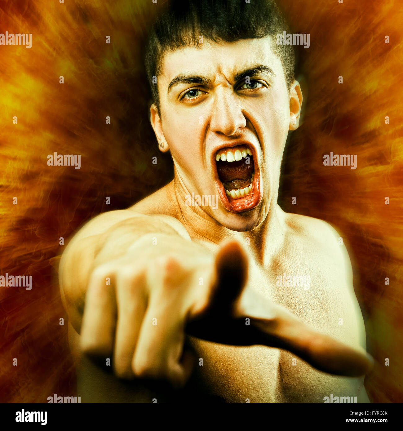 Angry Furious Man Screaming and Pointing Finger - Stock Image