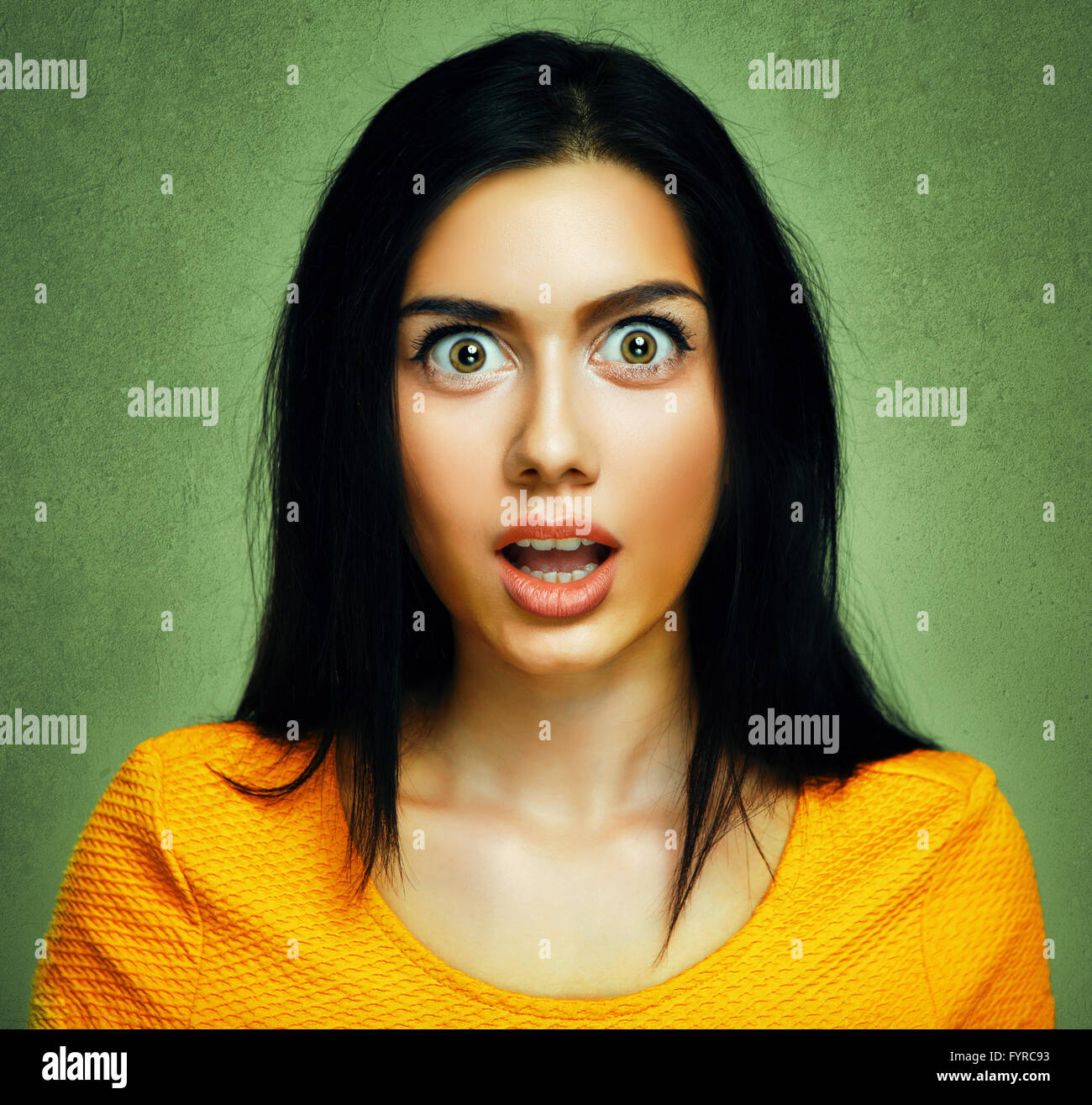 Surprised face of amazed shocked young woman - Stock Image
