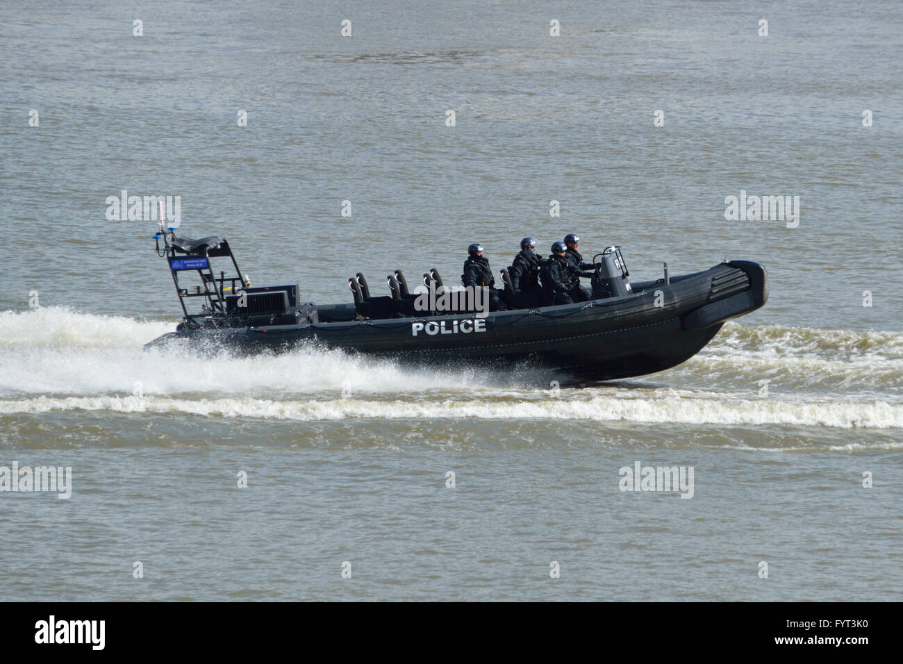 Met Police Marine Policing Unit RIB MP11 heading up the Thames in London UK - Stock Image