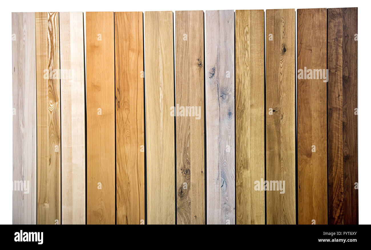 Colorful background texture and pattern of different wood varieties and colors in upright parallel planks in a full - Stock Image