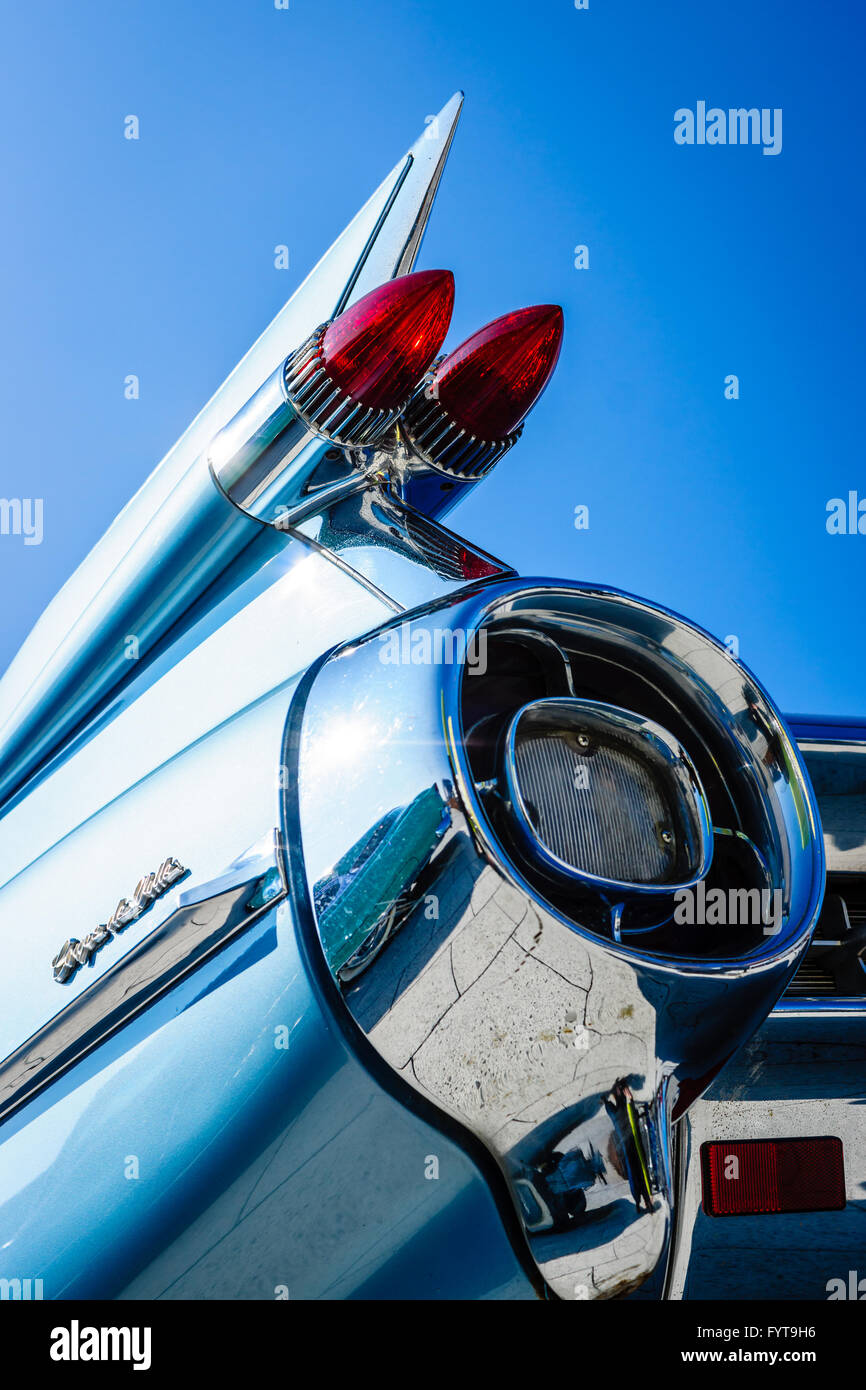 Detail of the rear wing and brake lights of the car Cadillac Coupe de Ville on the background of blue sky. - Stock Image