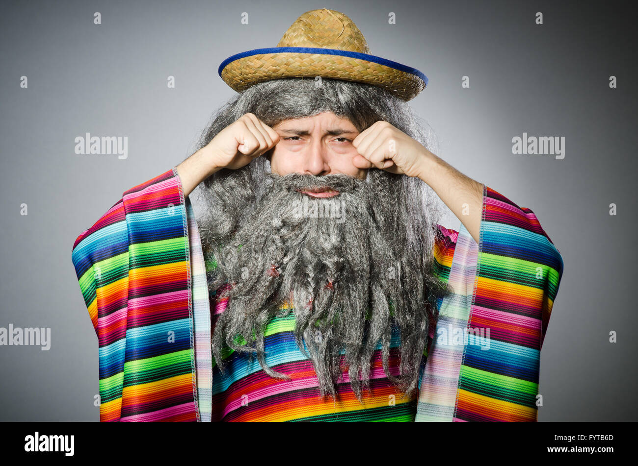 Person wearing sombrero hat in funny concept - Stock Image