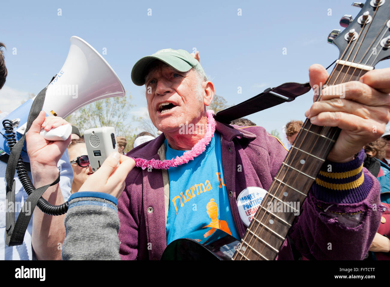 Protester singing folk songs at political rally - Washington, DC USA - Stock Image