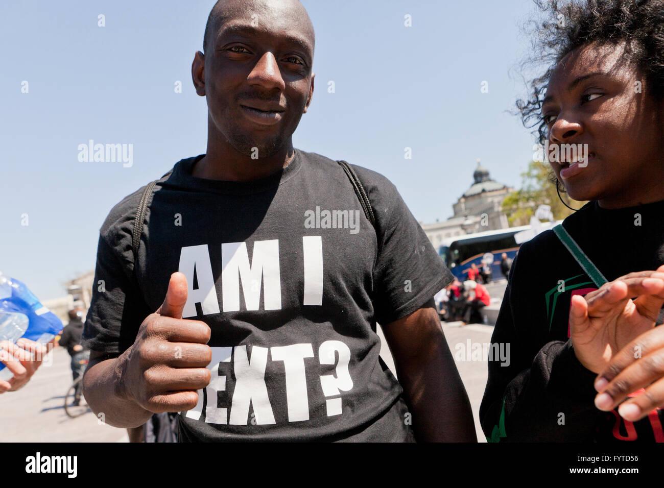 Black Lives Matter activist wearing 'Am I Next?' t-shirt - USA - Stock Image