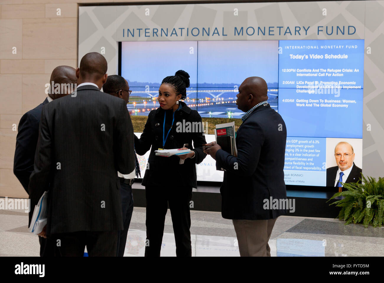 African delegation members having a business meeting  in the lobby of the IMF headquarters building - Washington, - Stock Image