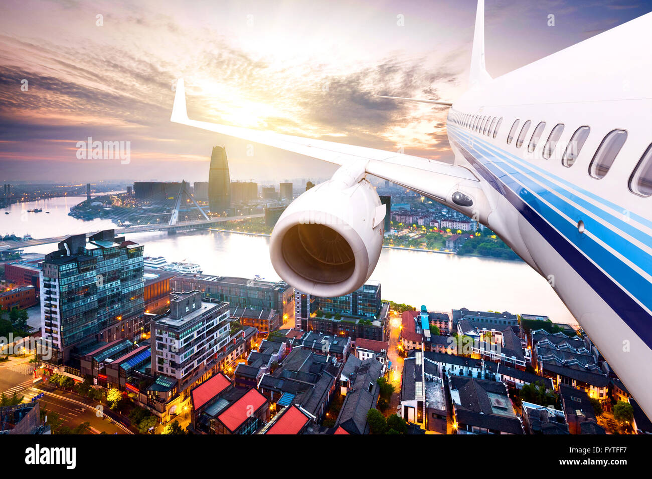 skyscape and cityscape at dusk from plane - Stock Image