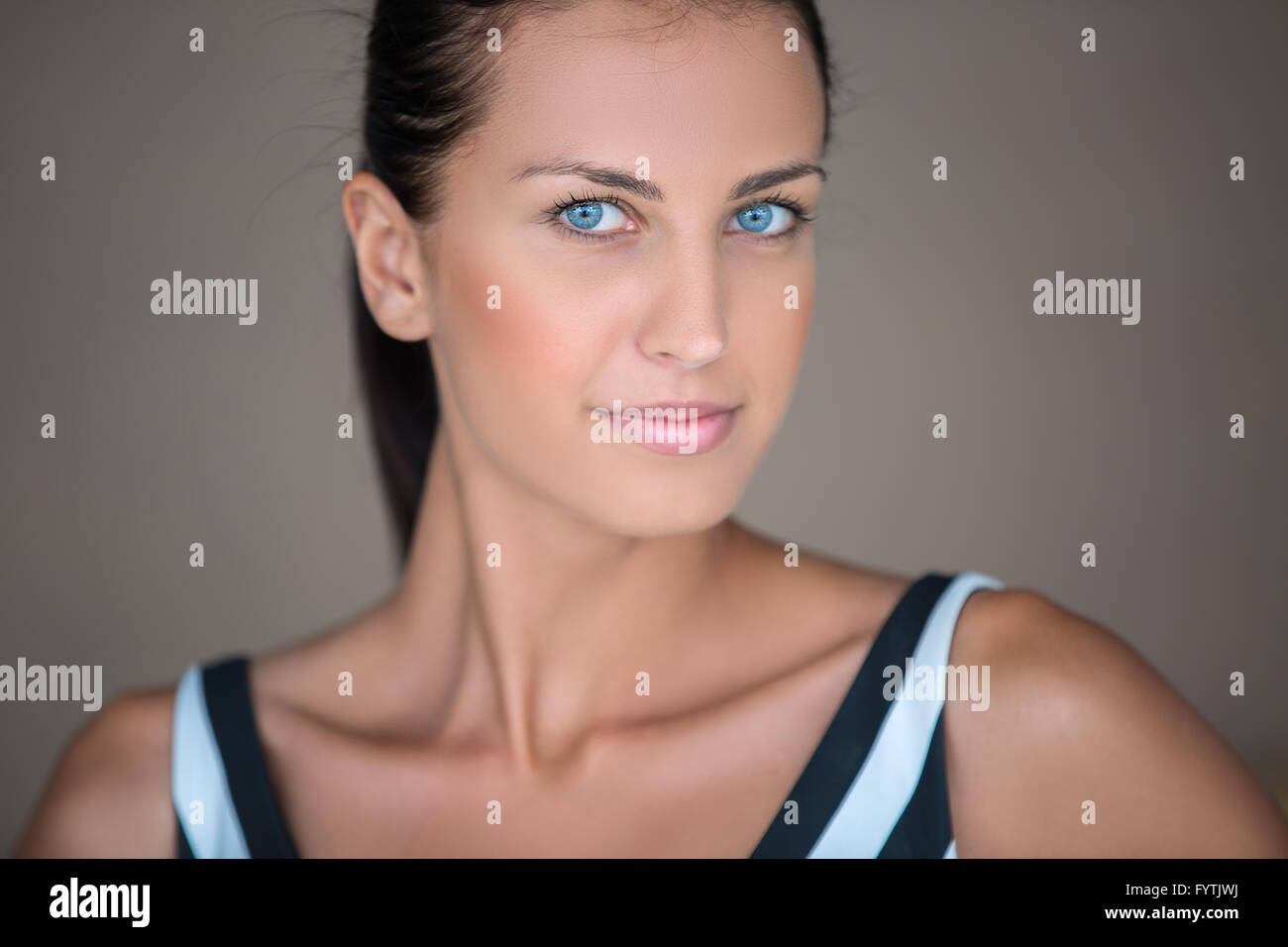 Blue-eyed girl with dark hair - Stock Image