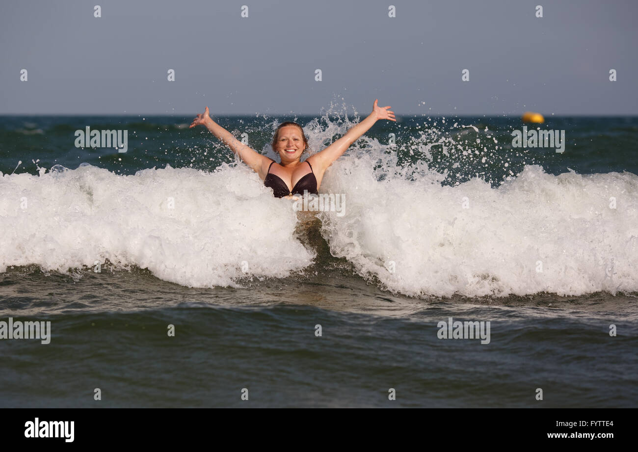 Woman has sent a wave - Stock Image