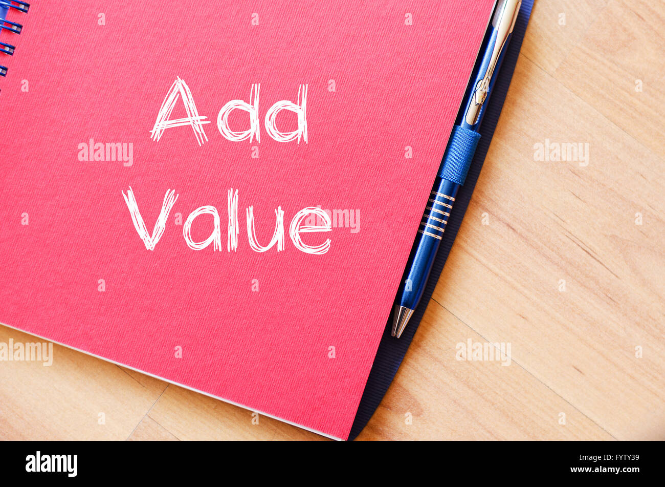 Add value write on notebook - Stock Image