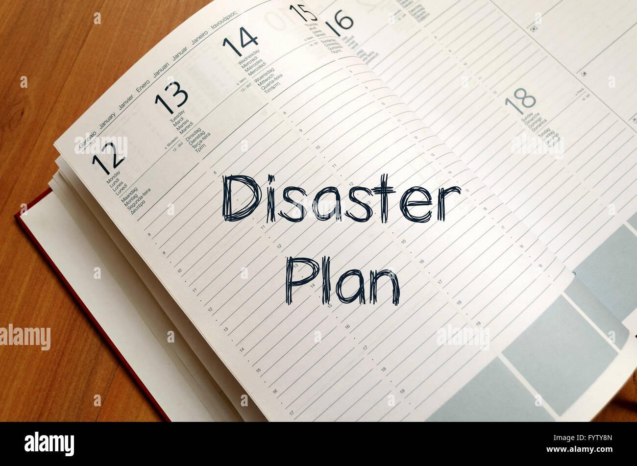Disaster plan write on notebook - Stock Image