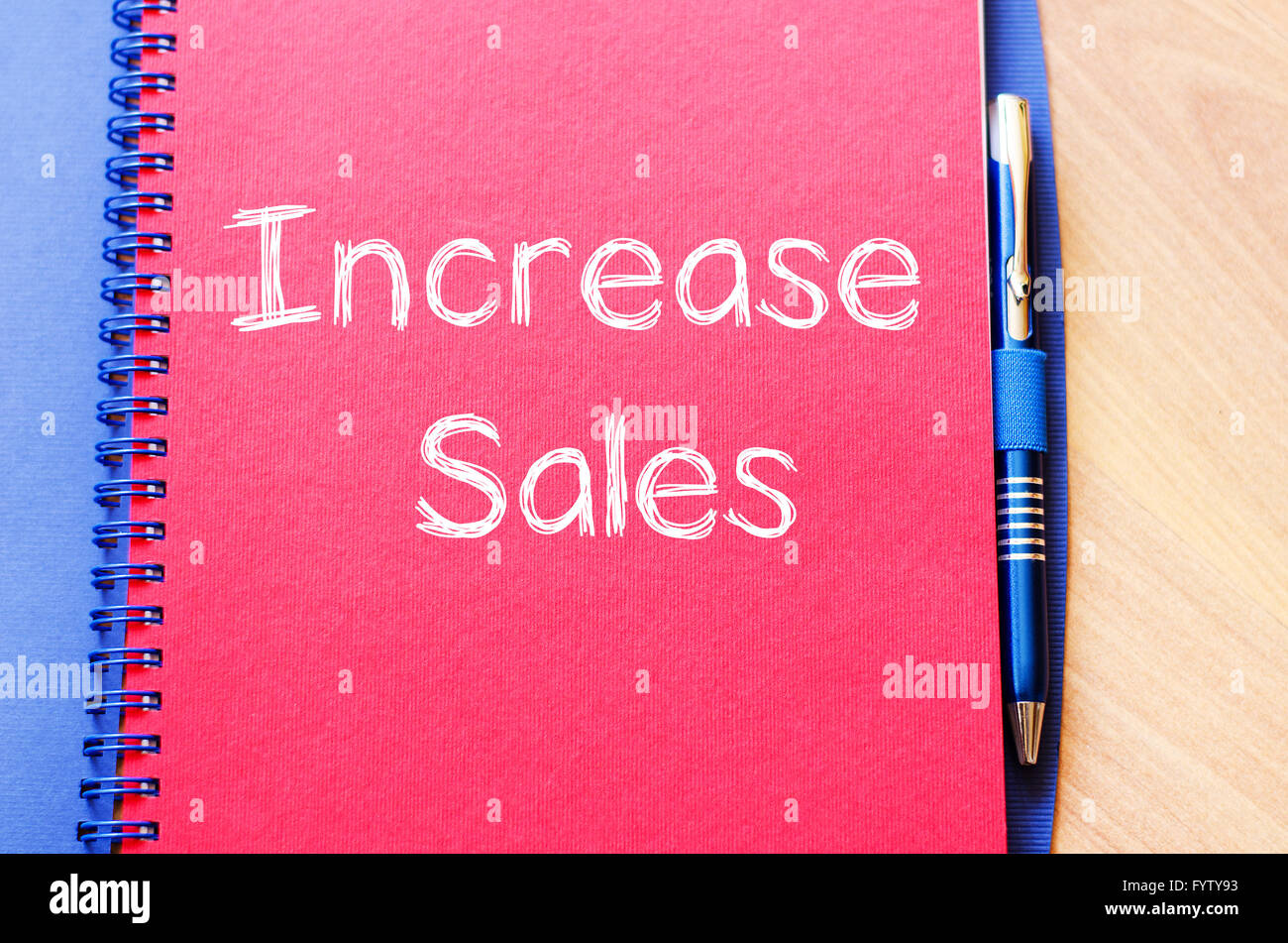 Increase sales write on notebook - Stock Image