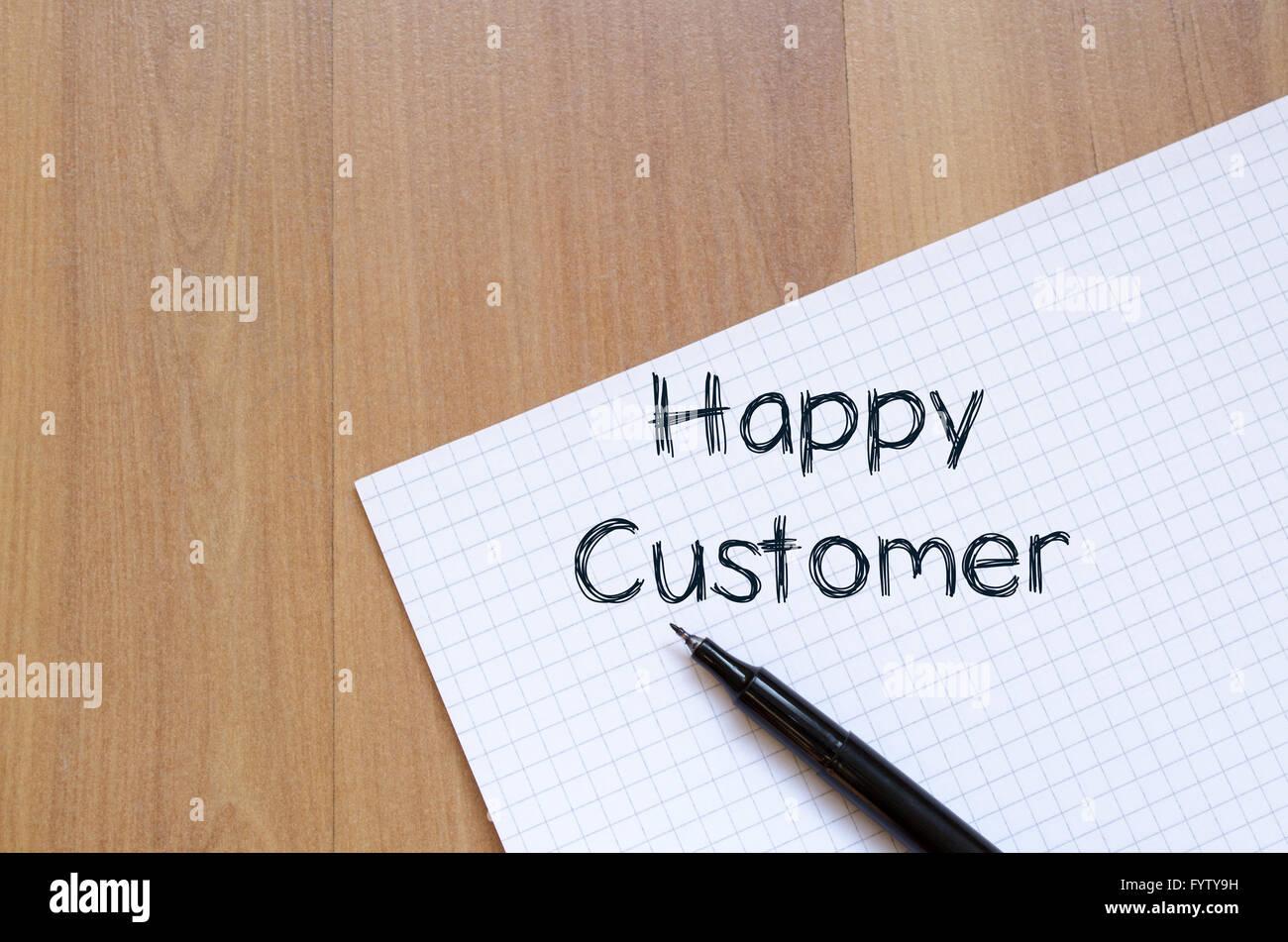 Happy customer write on notebook - Stock Image