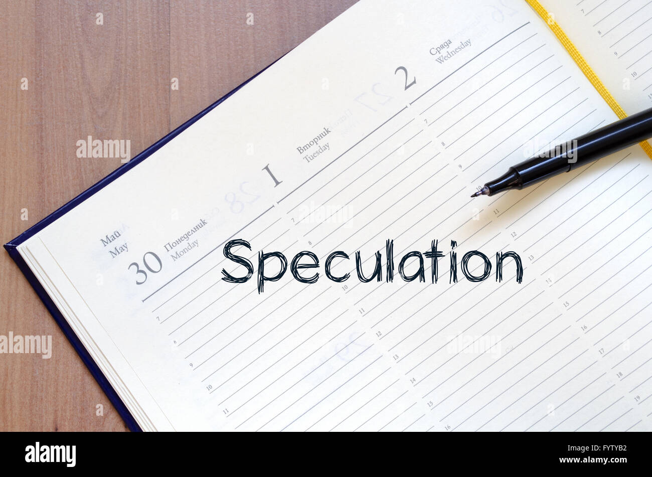 Speculation write on notebook Stock Photo