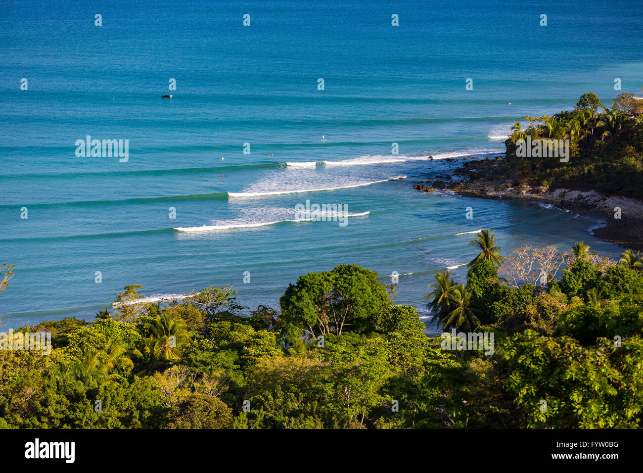 OSA PENINSULA, COSTA RICA - Pacific Ocean waves breaking at Pan Dulce beach, and rain forest. Stock Photo