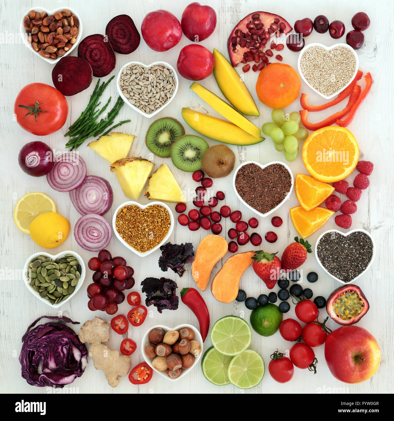 Paleolithic diet health and super food of fruit, vegetables, nuts and seeds on distressed white wooden background. - Stock Image