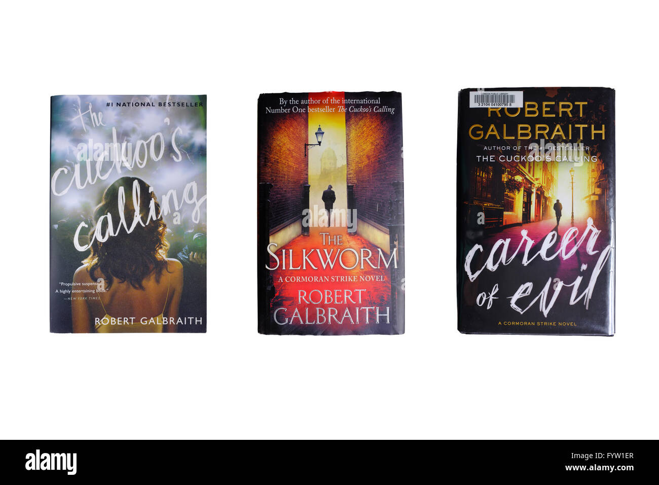 Three Robert Galbraith books photographed against a white background. - Stock Image