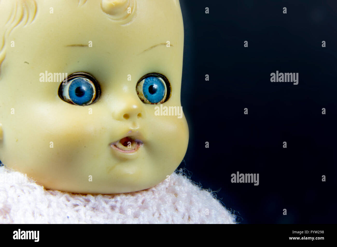 vintage doll, dolly, puppet,  old toy, retro, blue background, infant, infantile, childish - Stock Image