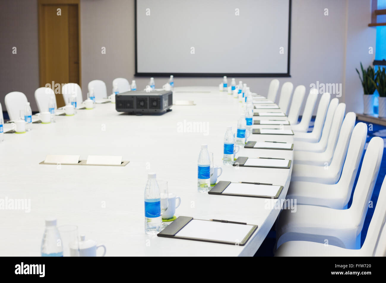 Picture of: Big Oval Meeting Table And White Board In Modern Meeting Room Stock Photo Alamy